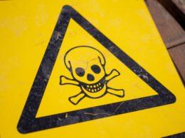 skull and cross bones caution sign